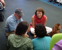 Presbyterians gather in small groups during the Big Tent workshop on Educate a Child.